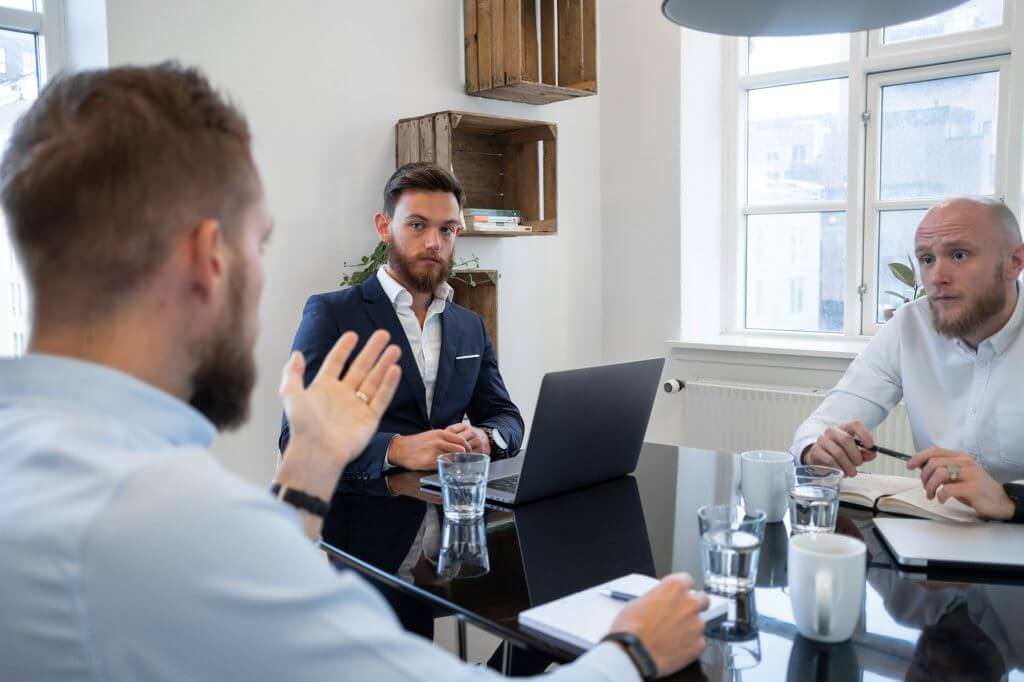 Image of men discussing in the office