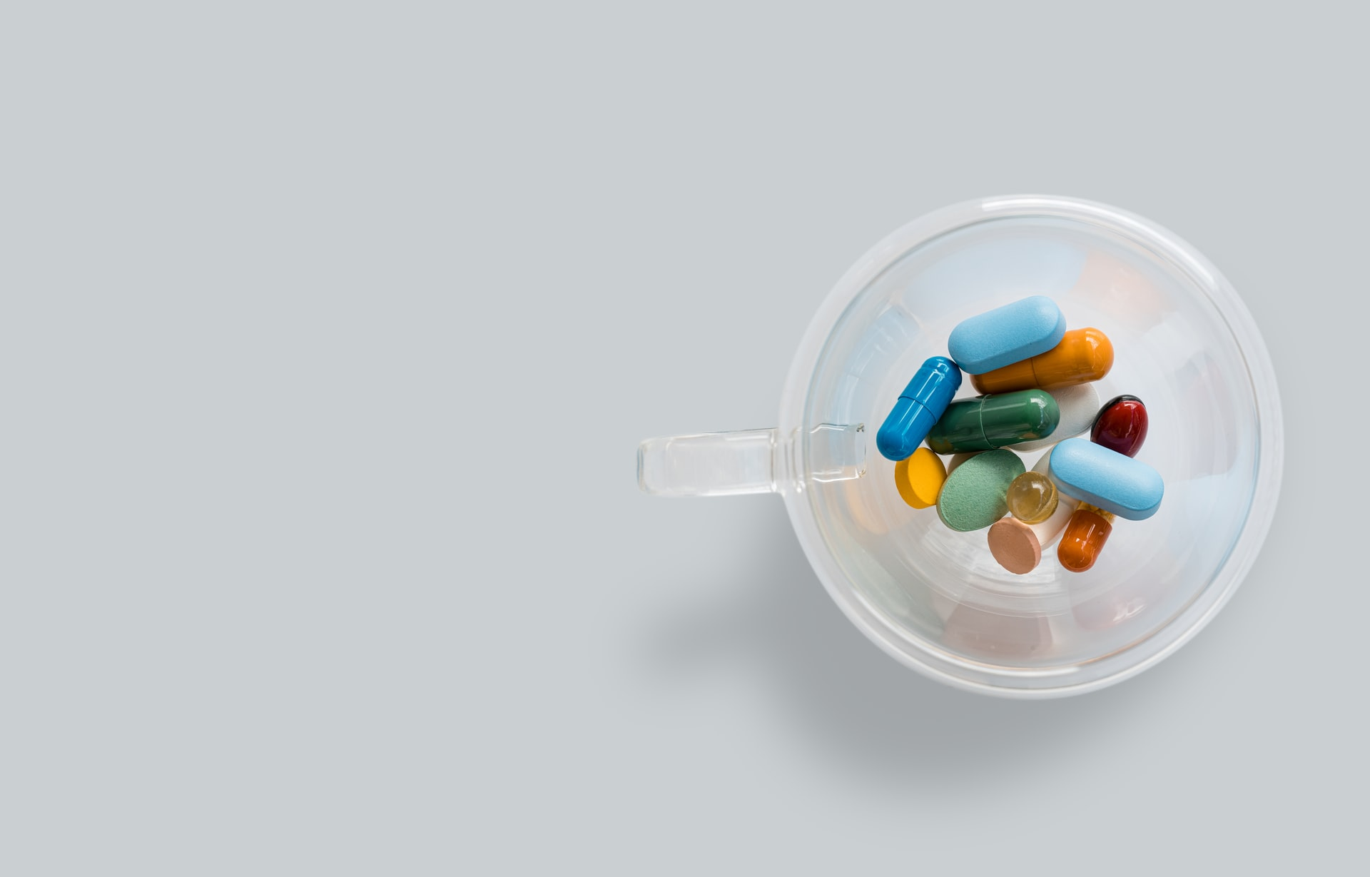 Image from Unsplash of multiple colored pills