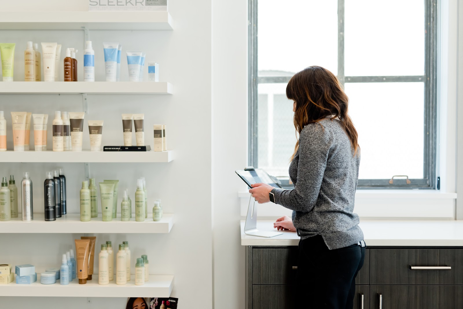 Image with customer looking at skincare products